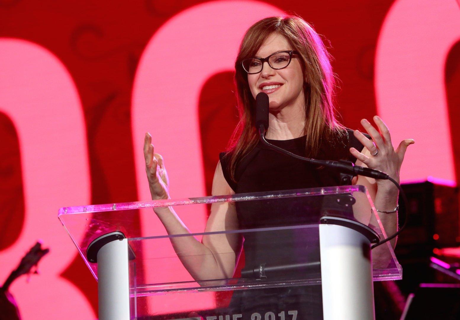 Singer-songwriter Lisa Loeb speaks on stage at the She Rocks Awards during the 2017 NAMM Show at the Anaheim Convention Center on January 20, 2017 in Anaheim, California. (Photo by Jesse Grant/Getty Images for NAMM)